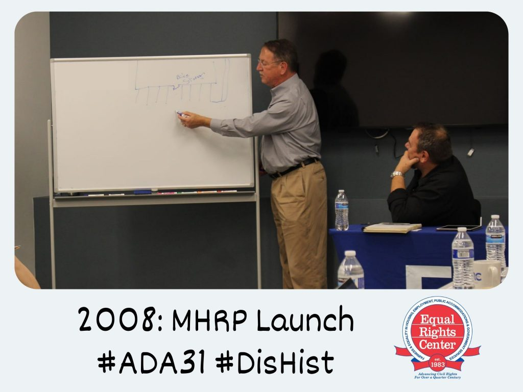 Polaroid-style photograph of accessibility experts Mark Mazz and Bill Hecker at the ERC's 2019 MHRP annual meeting. Mark draws a diagram on a whiteboard as Bill looks on. Captioned, 2008: MHRP Launch #ADA31 #DisHist