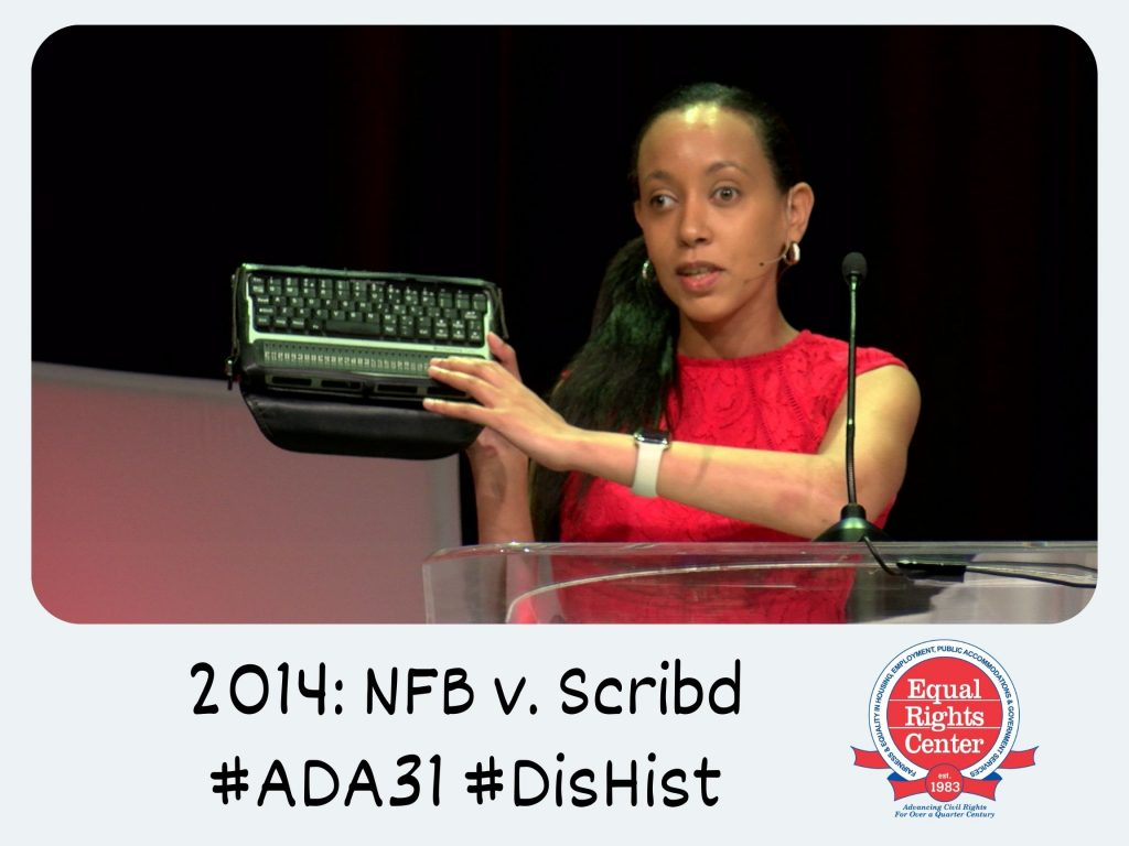 Polaroid-style photograph of Haben Girma at a podium holding a computer keyboard and braille display. Captioned, 2014: NFB v. Scribd #ADA31 #DisHist