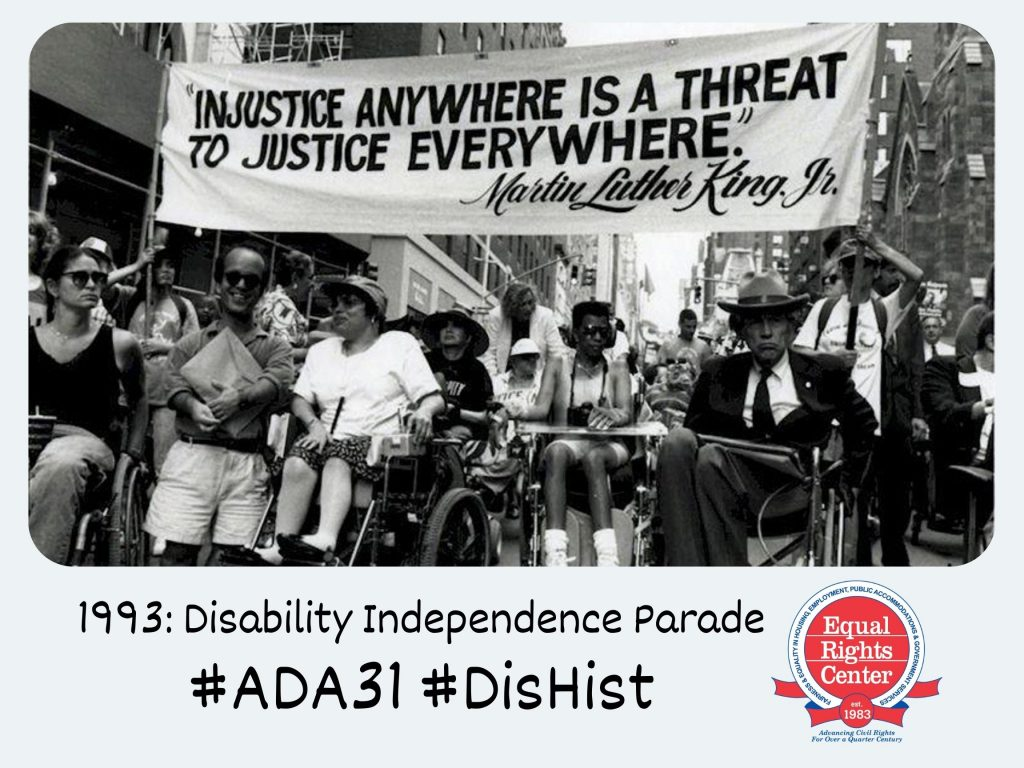 Polaroid-style photograph of disability rights activists including Paul S. Miller, Judy Heumann, Phyllis Rubenfeld, and Justin Dart participating in a parade. A banner above them reads, Injustice anywhere is a threat to justice everywhere. Captioned, 1993: Disability Independence Parade #ADA31 #DisHist