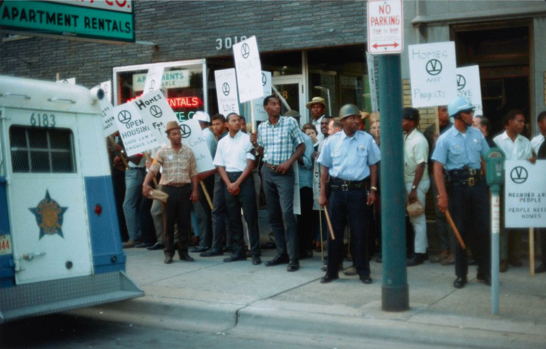 A group of protestors holding signs during the Chicago Freedom Movement