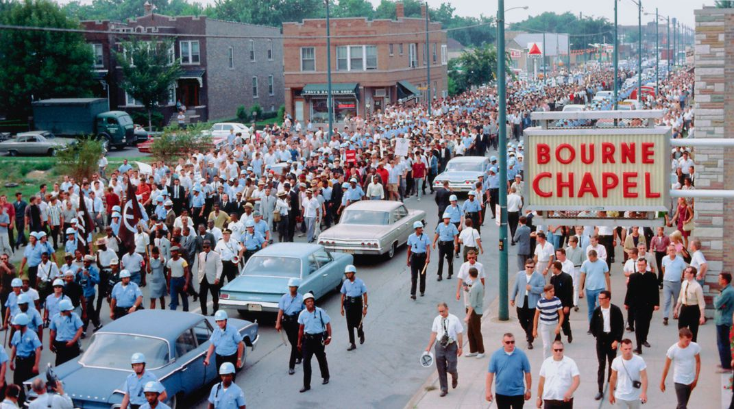 Hundreds of protestors march down a street during the Chicago Freedom Movement